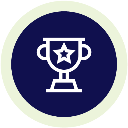 Line illustration of a trophy on a navy blue circle